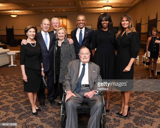 In this handout provided by Paul Morse/George W. Bush Presidential Center, Former first lady Laura Bush, former President George W. Bush, former...