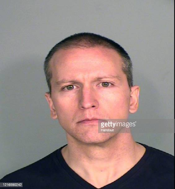 In this handout provided by Ramsey County Sheriff's Office former Minneapolis police officer Derek Chauvin poses for a mugshot after being charged in...