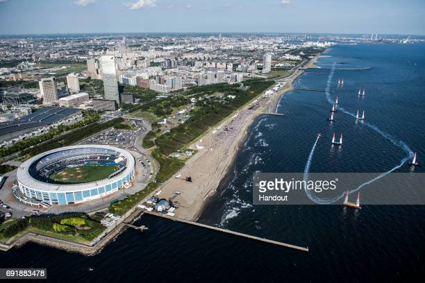 In this handout provided by Red Bull, Nicolas Ivanoff of France performs during the qualifying day at the third stage of the Red Bull Air Race World...