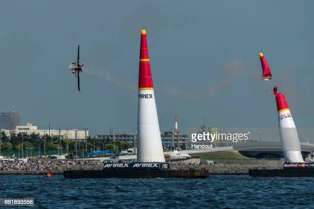 In this handout provided by Red Bull Nicolas Ivanoff of France performs during the qualifying day at the third stage of the Red Bull Air Race World...