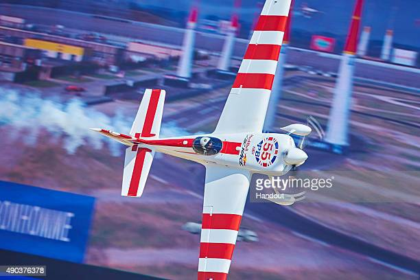 In this handout provided by Red Bull Paul Bonhomme of Great Britain performs in front of of of the world's biggest screens during the finals of the...