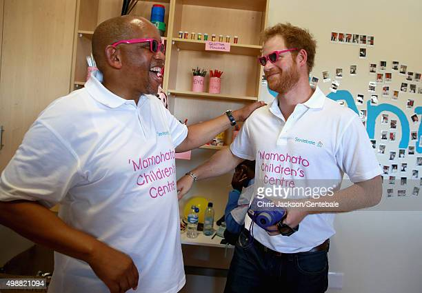 In this handout provided by Sentebale Prince Harry takes a photograph of Prince Seeiso using a Fuji Instax camera during a photography activity at...