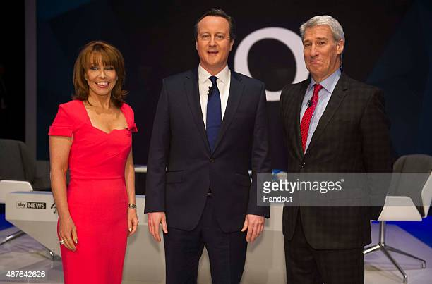In this handout provided by Sky News Kay Burley of Sky News British Prime Minister David Cameron and Jeremy Paxman of Channel 4 pose ahead of the...