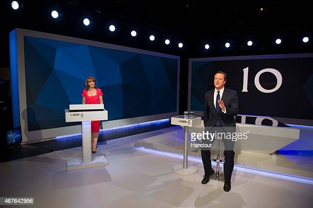 In this handout provided by Sky News Kay Burley of Sky News listens as British Prime Minister David Cameron speaks during the filming of 'Cameron...