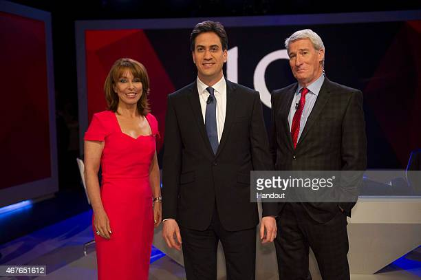 In this handout provided by Sky News Kay Burley of Sky News poses with Labour Party Leader Ed Miliband and and Jeremy Paxman of Channel 4 ahead of...