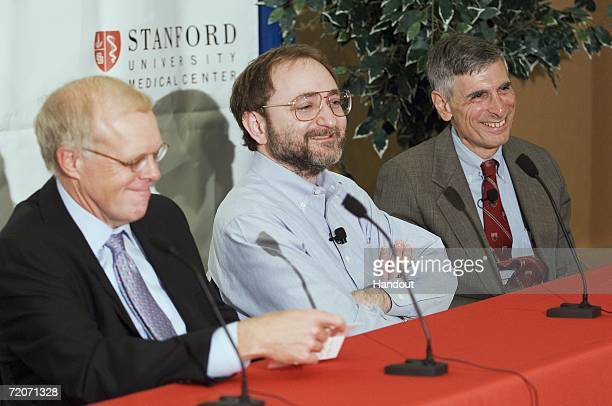 In this handout provided by Stanford University News Service Stanford President John Hennessy Nobel Laureate Andrew Fire and Phil Pizzo dean of the...