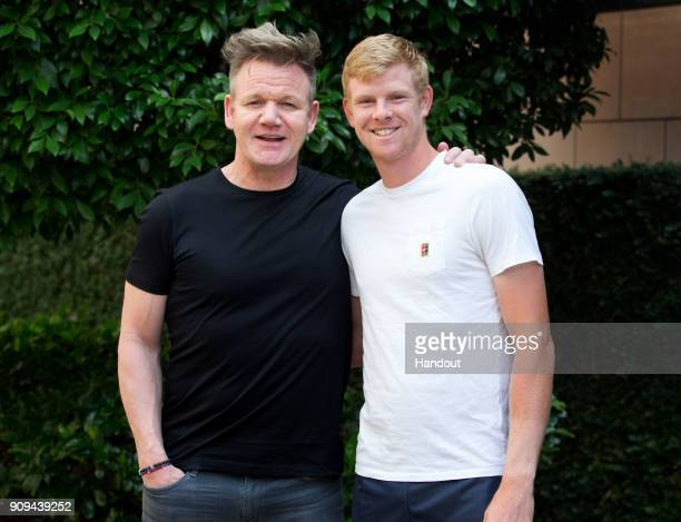 In this handout provided by Tennis Australia Kyle Edmund of Great Britain poses with Gordon Ramsay during day 10 of the 2018 Australian Open on...