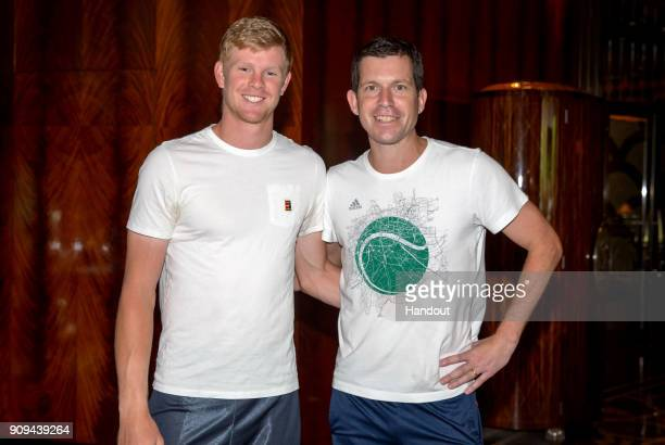 In this handout provided by Tennis Australia Kyle Edmund of Great Britain poses with Tim Henman during day 10 of the 2018 Australian Open on January...