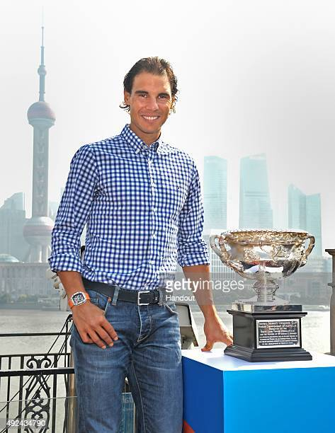 In this handout provided by Tennis Australia Rafael Nadal poses with the Norman Brookes Challenge Cup during the international launch of the...