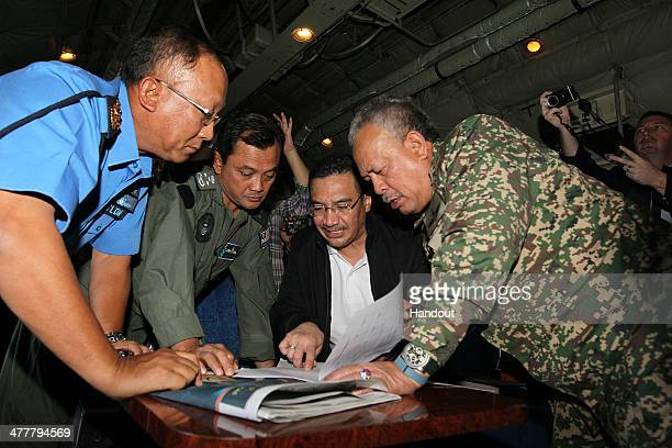 In this handout provided by the Angkatan Tentera Malaysia, Malaysian Royal Navy commander Tan Sri Abdul Aziz Jaafar , Lieutenant General Dato' Sri...