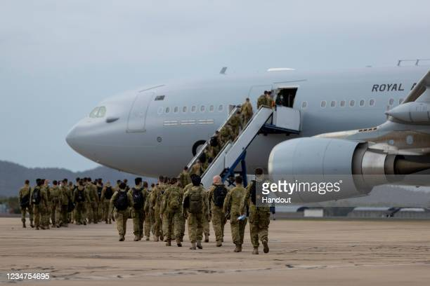 In this handout provided by the Australian Department of Defence, Australian Army personnel from the 3rd and 17th Brigades board a Royal Australian...
