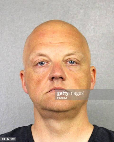 In this handout provided by the Broward Sheriff's Office suspect Oliver Schmidt an executive for Volkswagen poses in this undated booking photo...