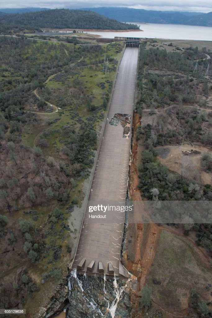 In this handout provided by the California Department of Water Resources (pixel.water.ca.gov), The California Department of Water Resources has suspended flows from the Oroville Dam spillway after a concrete section eroded on the middle section of the spillway February 7, 2017 in Oroville, California. Almost 200,000 people were ordered to evacuate the northern California town after a hole in an emergency spillway in the Oroville Dam threatened to flood the surrounding area.