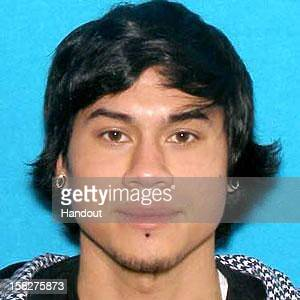 In this handout provided by the Clackamas Co Sheriff's Office suspect Jacob Tyler Roberts poses in this undated photo in an unspecified loaction On...