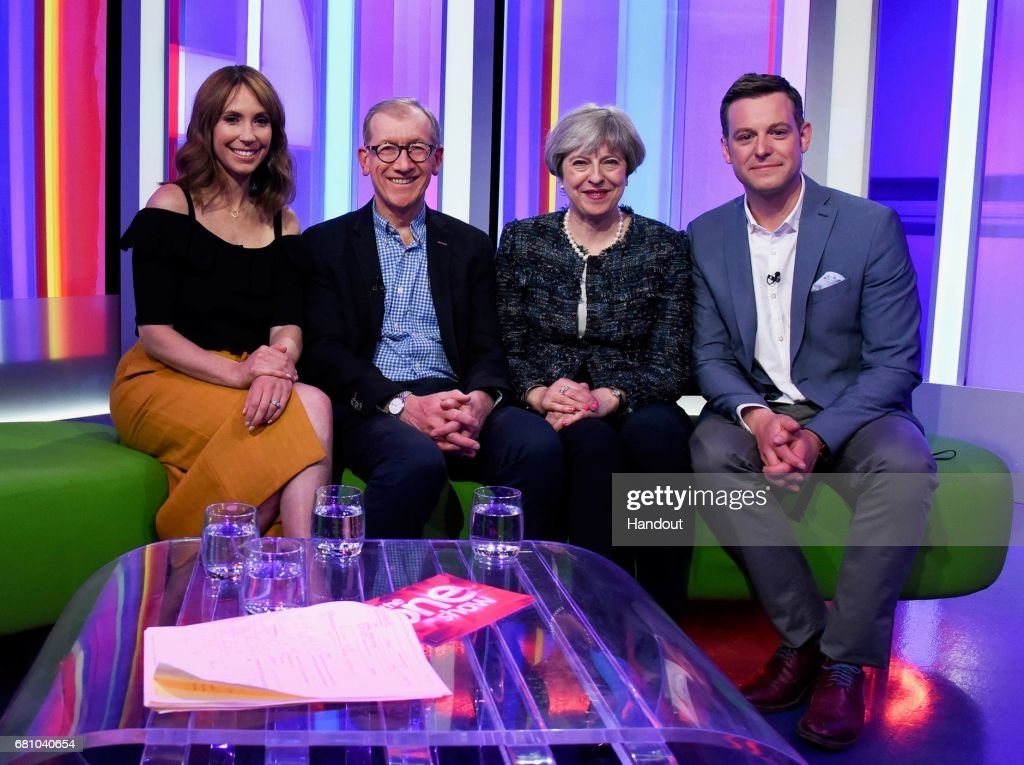 In this handout provided by The Conservative Party, British Prime Minister Theresa May (2nd, R) and her husband Philip May (2nd, L) pose with presenters Alex Jones (L) and Matt Baker as they appear on BBC's The One Show at the BBC's Broadcasting House on May 9, 2017 in London, England. Campaigning is underway ahead of the June 8th general election.