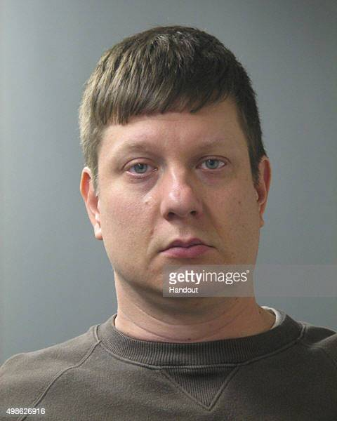 In this handout provided by the Cook County State's Attorney's Office Chicago police officer Jason Van Dyke poses for a mugshot photo after he was...