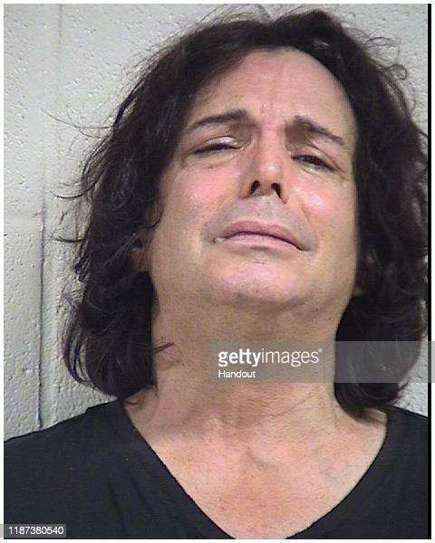 In this handout provided by the Dallas Fort Worth International Airport actor Richard Grieco poses for a mugshot after being arrested at...