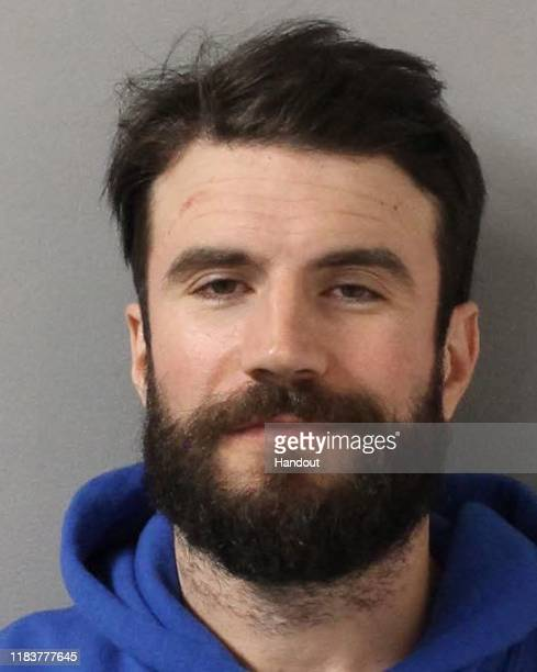 In this handout provided by the Davidson County Sheriff country singer Sam Hunt poses for a mugshot image after being arrested on DUI charges...