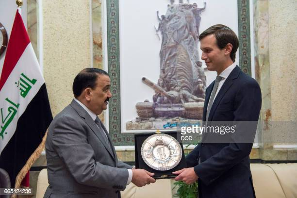 In this handout provided by the Department of Defense Jared Kushner Senior Advisor to President Donald J Trump receives a gift from Iraqi Minister of...