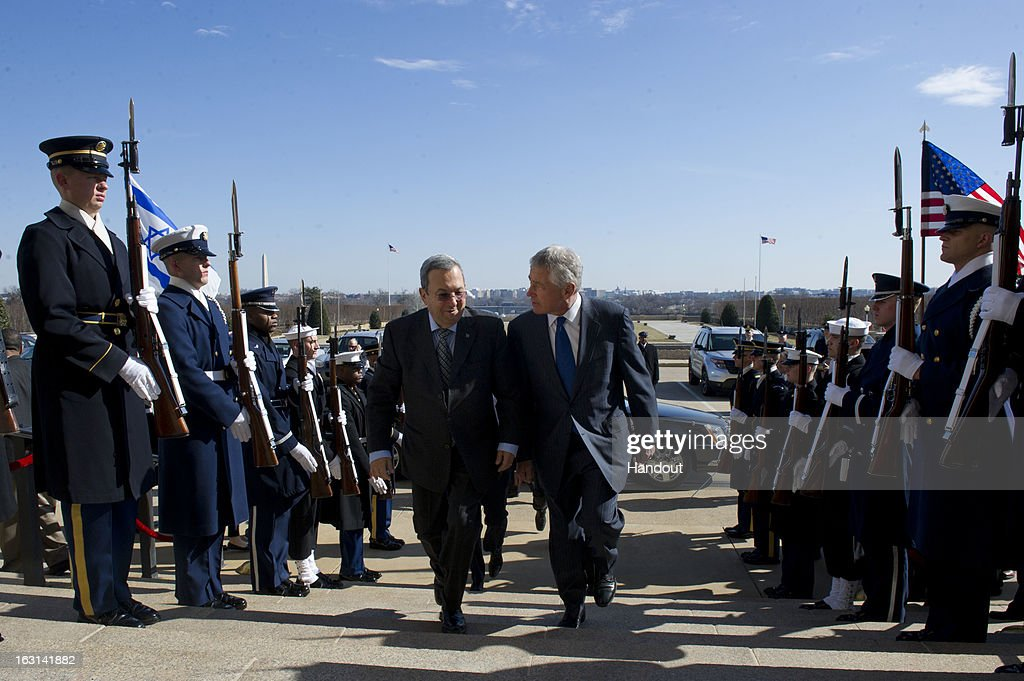In this handout provided by the Department of Defense, U.S. Secretary of Defense Chuck Hagel (R) escorts Israeli Minister of Defense Ehud Barak during an honor cordon arrival ceremony at the Pentagon March 5, 2013 in Arlington, Virginia. Hagel and Barak were scheduled to meet privately at the Pentagon.