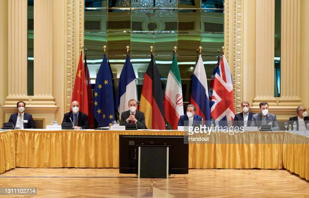 In this handout provided by the EU Delegation in Vienna, Representatives of the European Union and Iran attend the Iran nuclear talks at the Grand...