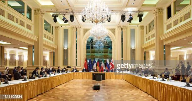 In this handout provided by the EU Delegation in Vienna, Representatives of the European Union, Iran and others attend the Iran nuclear talks at the...