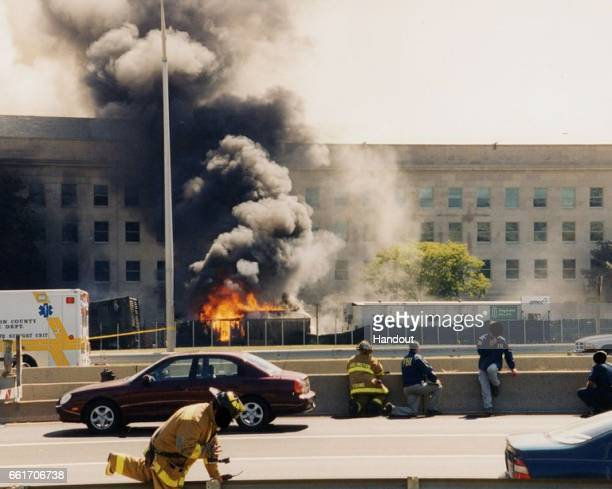 In this handout provided by the Federal Bureau of Investigation first responders on scene following an attack at the Pentagon on September 11 2001 in...