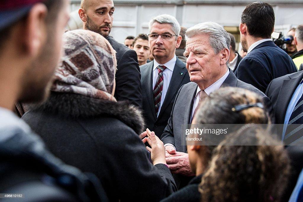 German President Joachim Gauck Visits Refugees At  Shelter : News Photo