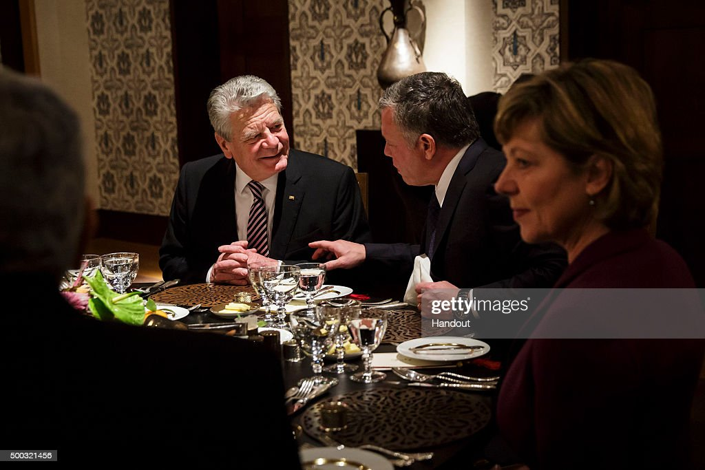 In this handout provided by the German Government Press Office (BPA), (L-R) President of Germany Joachim Gauck, King Abdullah II of Jordan and German First Lady Daniela Schadt attend a dinner in the Palace at Al Urdon on December 07, 2015 in Amman, Jordan. The German President is visiting Jordan to talk about both regional and international developments.