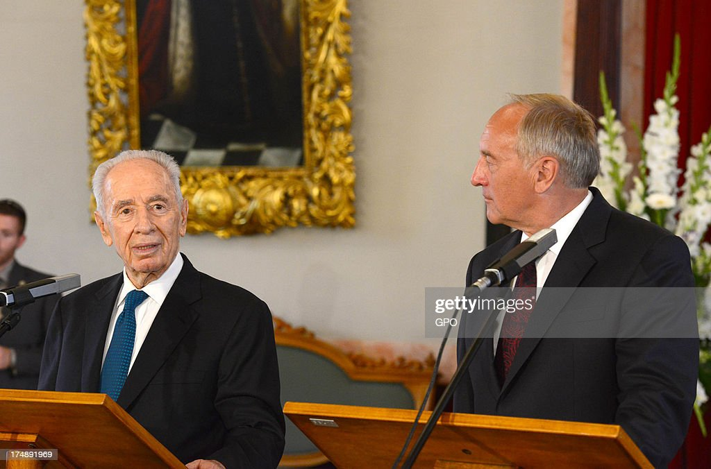 In this handout provided by the GPO, Israeli President Shimon Peres (L) with Latvia President Andris Berzinns during a meeting on July 29, 2013 in Riga, Latvia. Shimon Peres has embarked on a state visit to Latvia and Lithuania.