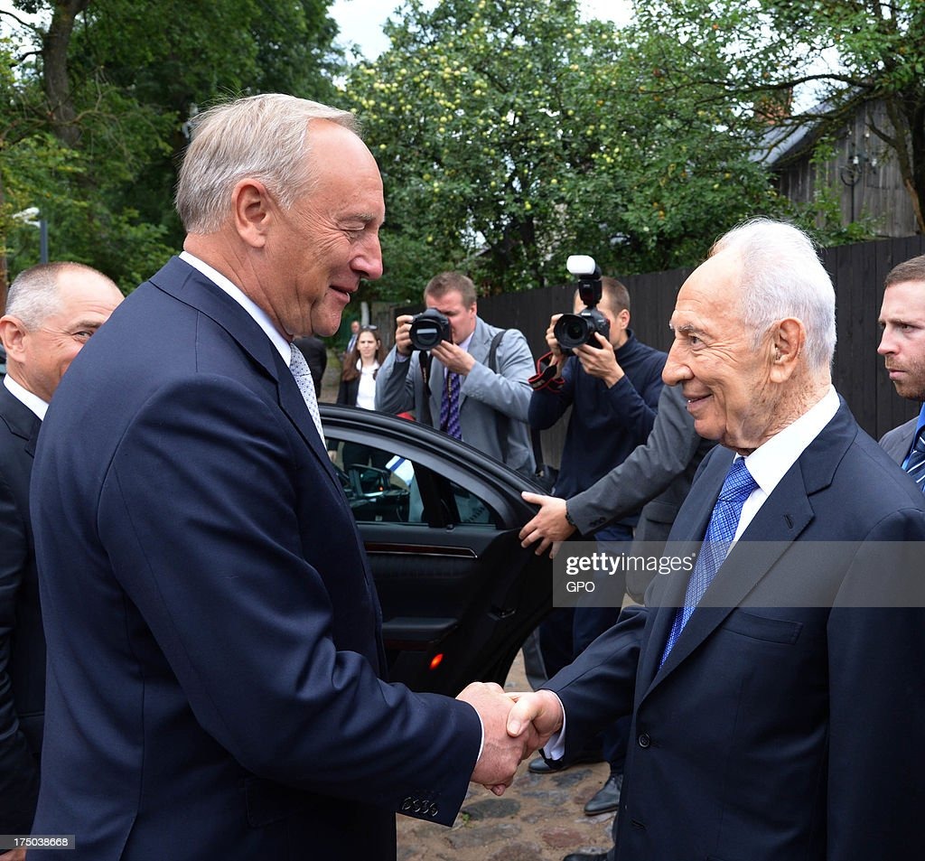 In this handout provided by the GPO, Israeli President Shimon Peres (L) shakes hands with Latvia President Andris Berzinns during a meeting on July 30, 2013 in Riga, Latvia. Shimon Peres has embarked on a state visit to Latvia and Lithuania.