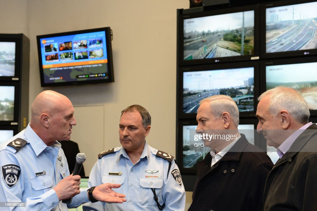 In this handout provided by the GPO, Israeli Prime Minister Benjamin Netanyahu (2nd R), Internal Security Minister Yitzhak Aharonovitch (R), Police Commissioner Yohanan Danino (2nd L) and Major General Bruno Stein (L), head of the Israel Police's traffic division, during a visit to The National Traffic Police Headquarters on January 09, 2013 in Israel. Netanyahu thanked officers for their efforts during the 'Pillar of Defense' - the seven day IDF operation in the Hamas governed Gaza Strip.