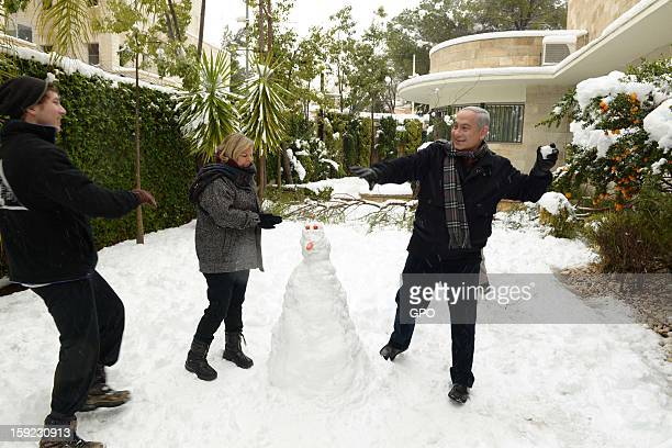 In this handout provided by the GPO Israeli Prime Minister Benjamin Netanyahu enjoys the snow with his family on January 10 2013 in Jerusalem Israel...