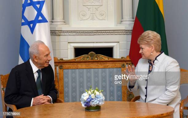 In this handout provided by the GPO President of Lithuania Dalia Grybauskaite and Israeli President Shimon Peres are seen during a meeting on July 31...