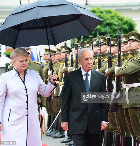 In this handout provided by the GPO President of Lithuania Dalia Grybauskaite welcomes Israeli President Shimon Peres to the presidential palace for...