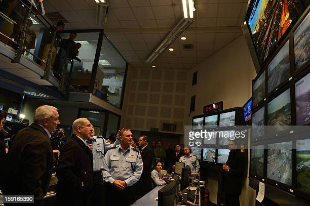 In this handout provided by the GPO, sraeli Prime Minister Benjamin Netanyahu , looks at monitors with Internal Security Minister Yitzhak...