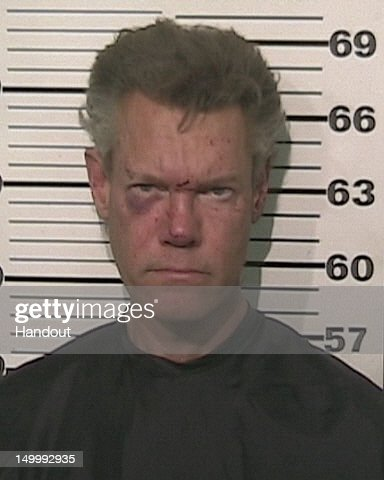 In this handout provided by the Grayson County Sheriff's Office, musician Randy Travis is seen in a police booking photo August 7, 2012 in Sherman, Texas. Travis was charged with misdemeanor DWI and felony Retaliation after he was involved in a one vehicle accident. He was later released on bond.