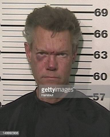 In this handout provided by the Grayson County Sheriff's Office musician Randy Travis is seen in a police booking photo August 7 2012 in Sherman...