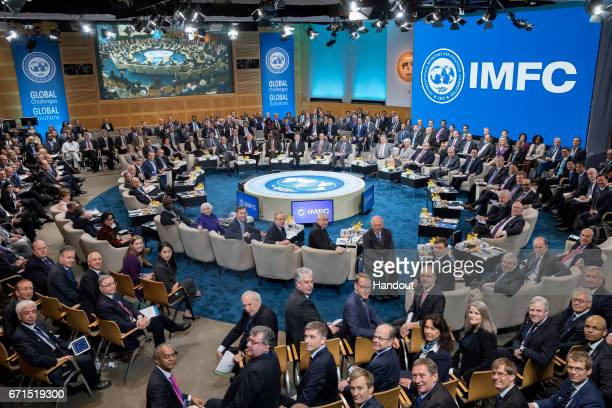 In this handout provided by the IMF, IMFC members pose for a photograph April 22, 2017 at the IMF Headquarters in Washington, DC. The IMF/World Bank...