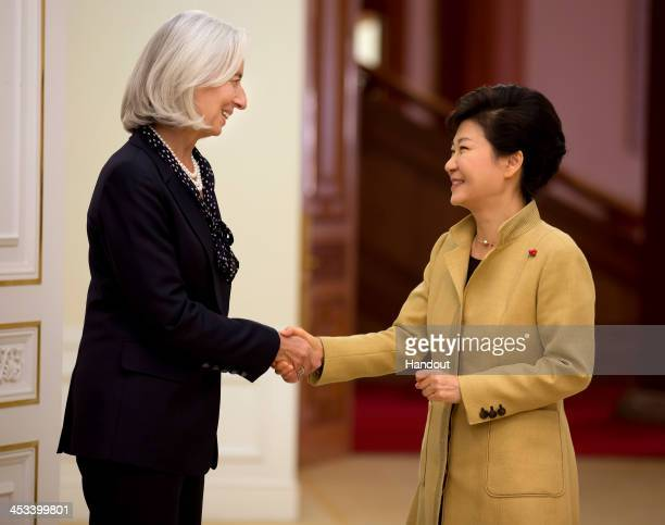 In this handout provided by the International Monetary Fund IMF Director Christine Lagarde meets with Korea's President Park Geunhye at the Blue...
