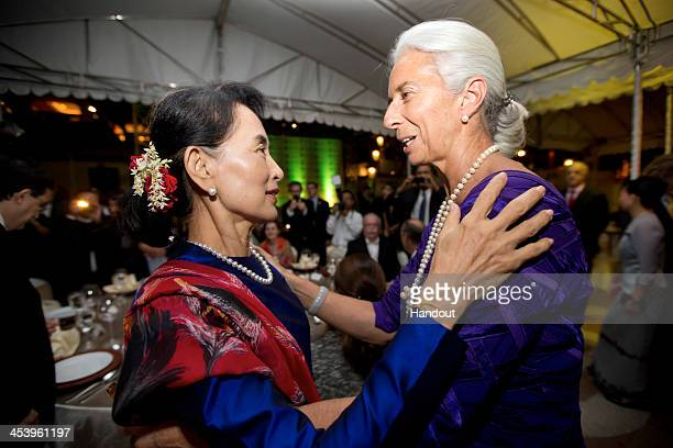 In this handout provided by the International Monetary Fund International Monetary Fund Managing Director Christine Lagarde greets Aung San Suu Kyi...