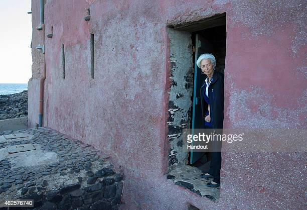 In this handout provided by the International Monetary Fund International Monetary Fund Managing Director Christine Lagarde looks out of the door of...