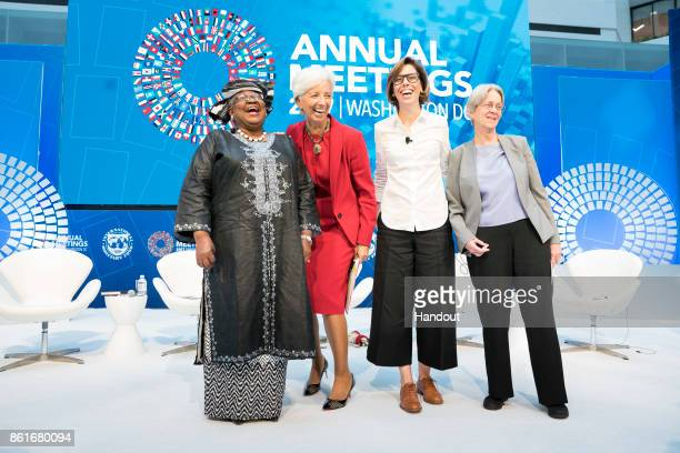In this handout provided by the International Monetary Fund International Monetary Fund Managing Director Christine Lagarde poses with a panel on...