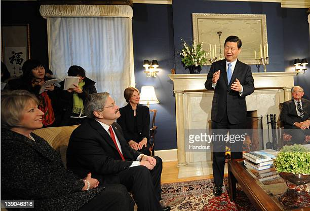 In this handout provided by the Iowa Governor's office Vice President Xi Jinping of the People's Republic of China meets Iowa Gov Terry Brandstad his...