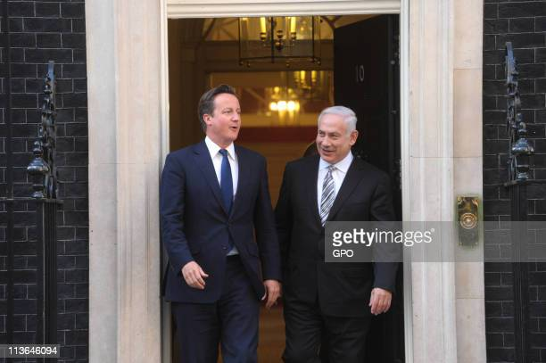 In this handout provided by the Israeli Government Press Office , British Prime Minister David Cameron greets Israeli Prime Minister Benjamin...