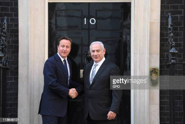 In this handout provided by the Israeli Government Press Office British Prime Minister David Cameron greets Israeli Prime Minister Benjamin Netanyahu...