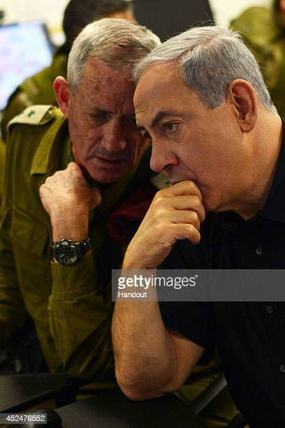 In this handout provided by the Israeli Government Press Office Israel Prime Minister Benjamin Netanyahu and IDF Chief of Staff Benny Gantz visit a...