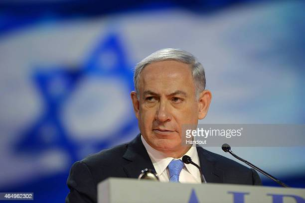 In this handout provided by the Israeli Government Press Office Israeli Prime Minister Benjamin Netanyahu speaks during the American Israel Public...