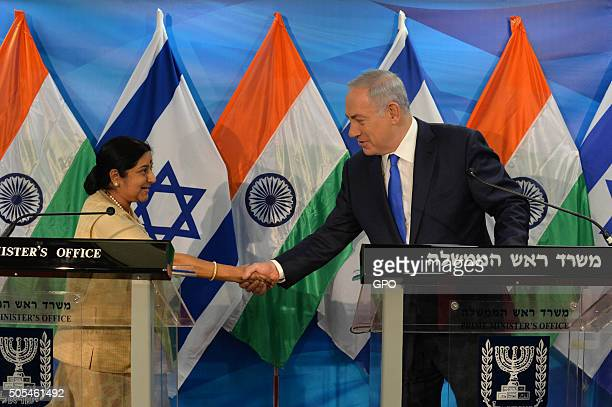 In this handout provided by the Israeli Government Press Office Israeli Prime Minister Benjamin Netanyahu shakes hands with Sushma Swaraj External...