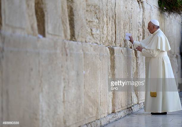 In this handout provided by the Israeli Government Press Office Pope Francis visits the Western Wall Judaism's holiest site in Jerusalem's Old City...